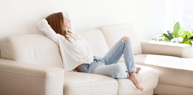 Woman Relaxing On Her Couch