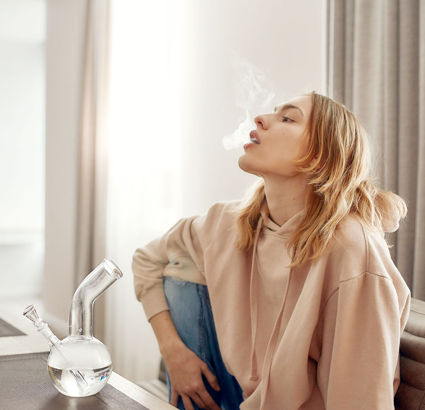 Woman Exhaling Cannabis Smoke